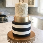 metallic gold and black and white wedding cake