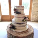 NAKED WEDDING CAKE FRESH GREENERY AND FLOWERS